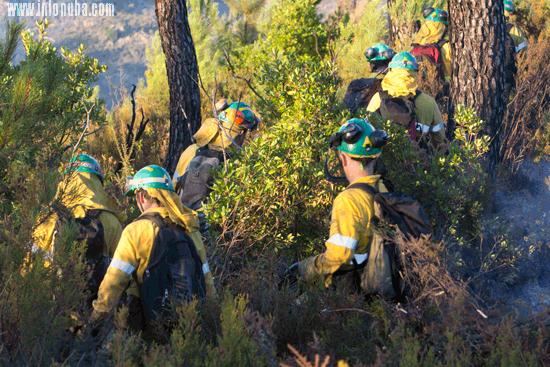 Imagen de bomberos en un incendio.