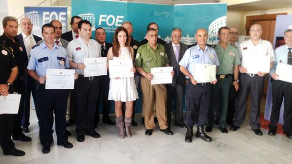 Autoridades y galardonados en la celebración del Día de la Seguridad Privada en Huelva.